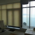 Vertical window blinds in a lounge by Blindology Blinds plymouth
